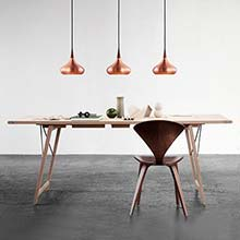Three Lightyears Orient Pendant Lights over a            modern dining table