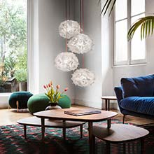Multiple Slamp Veli Pendant Lights in a mid-century living room